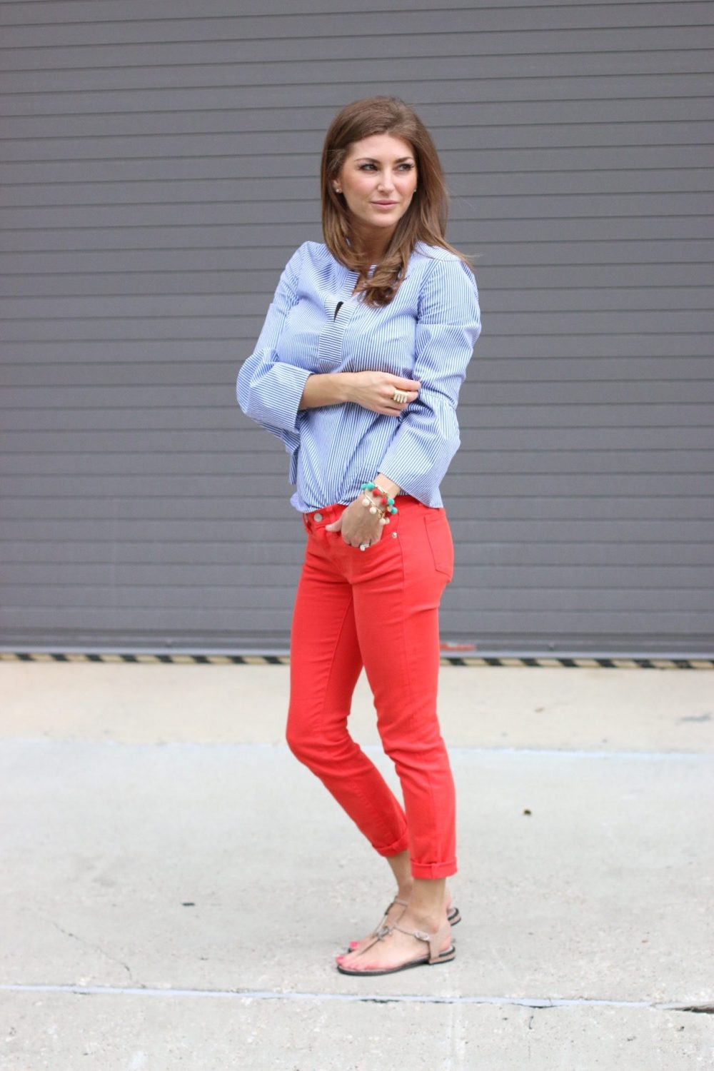 Showing off J. Crew outfit. Striped J. Crew top and red J. Crew pants