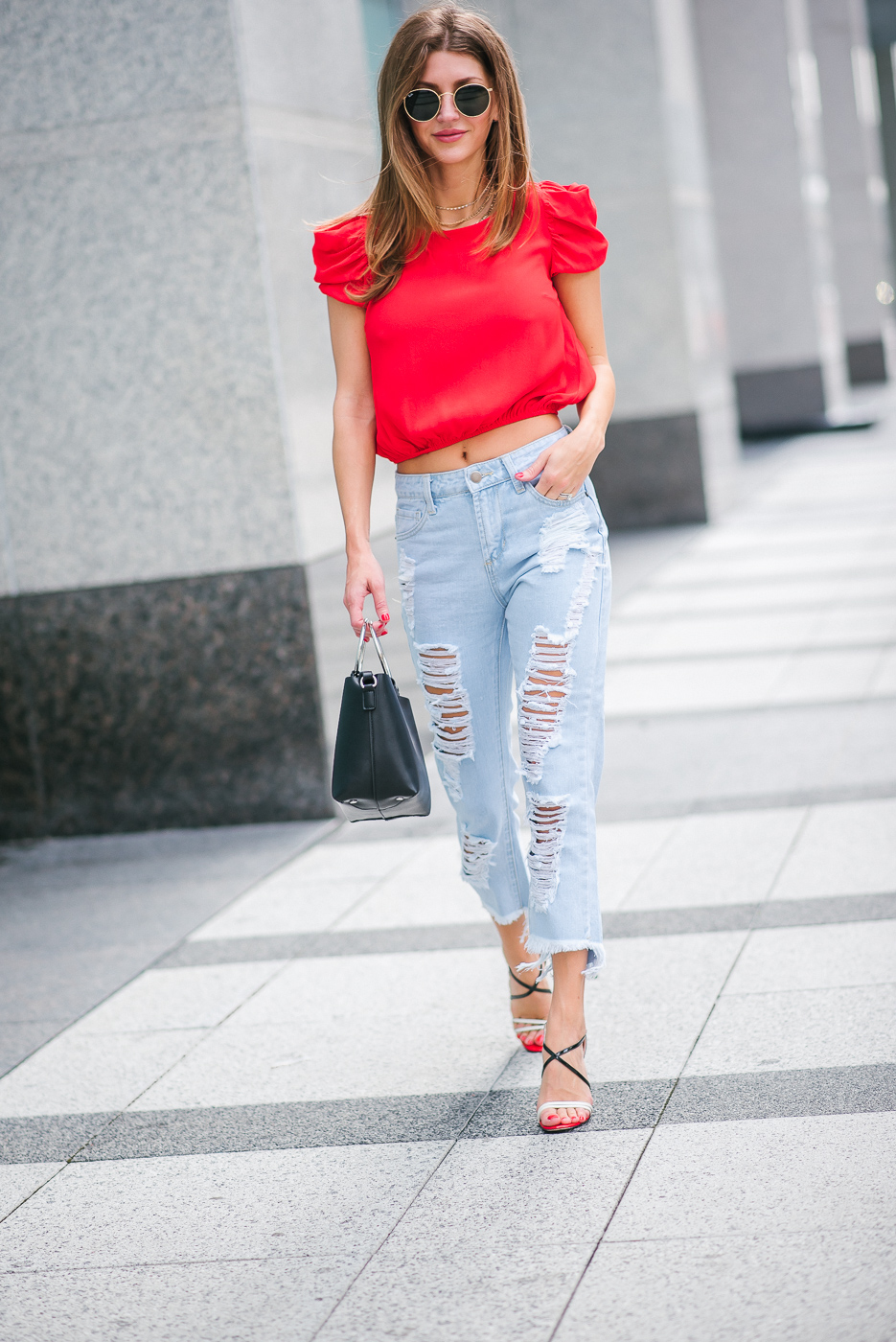 Lifestyle blogger Ashlee Frazier wearing bright red top
