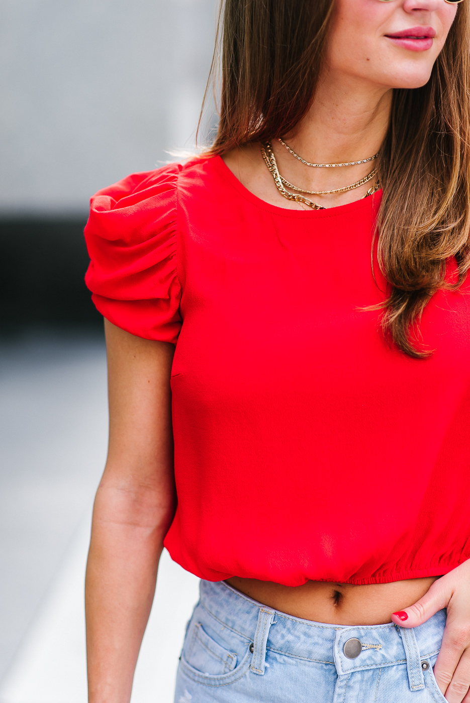 Fashion blogger wearing capped ruffle sleeves