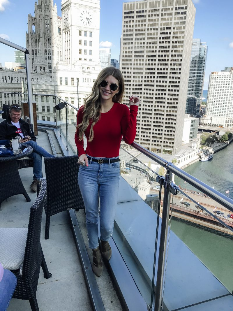 AshLee Frazier in Chicago over looking the skyline