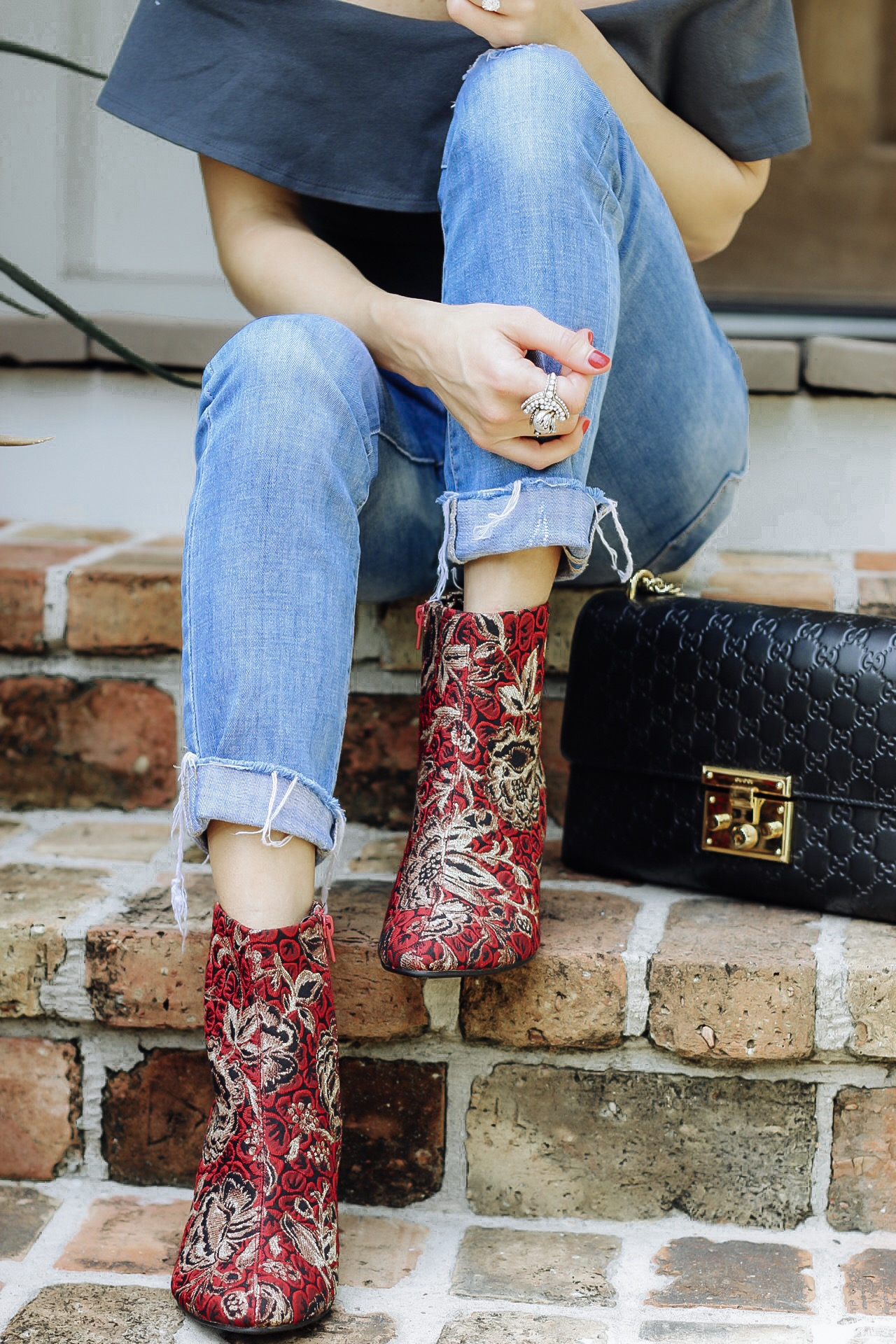 up close look of embroidered red and gold booties