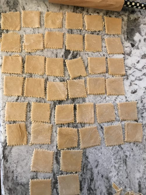 Cut out homemade cooking ravioli pasta for my best fall recipe of squash raviloli