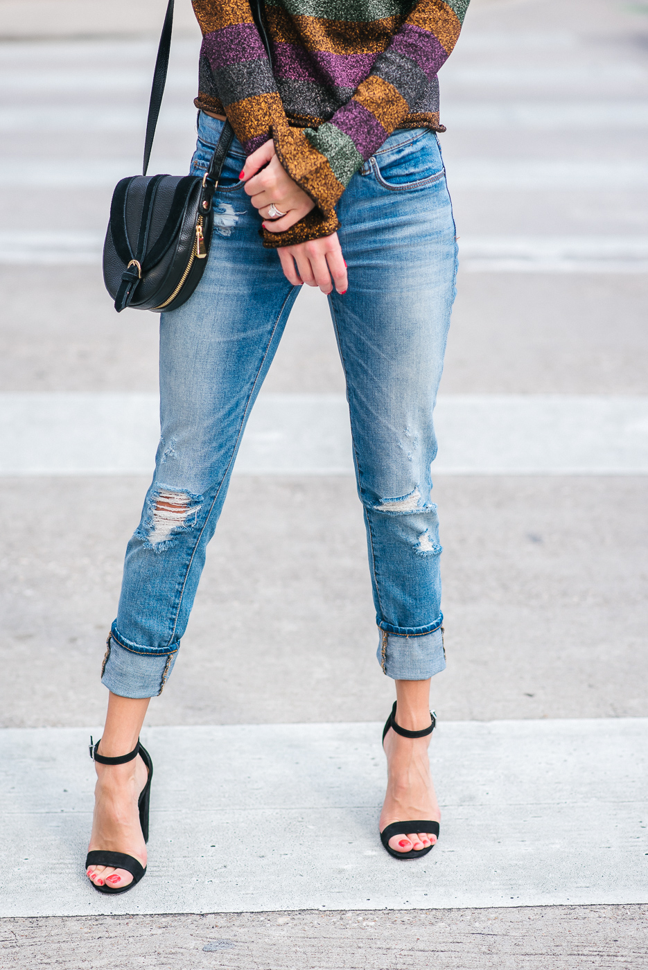 Street style blogger in distressed denim