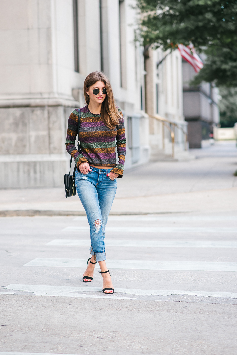 Fashionista street style in metallic long sleeve top and denim
