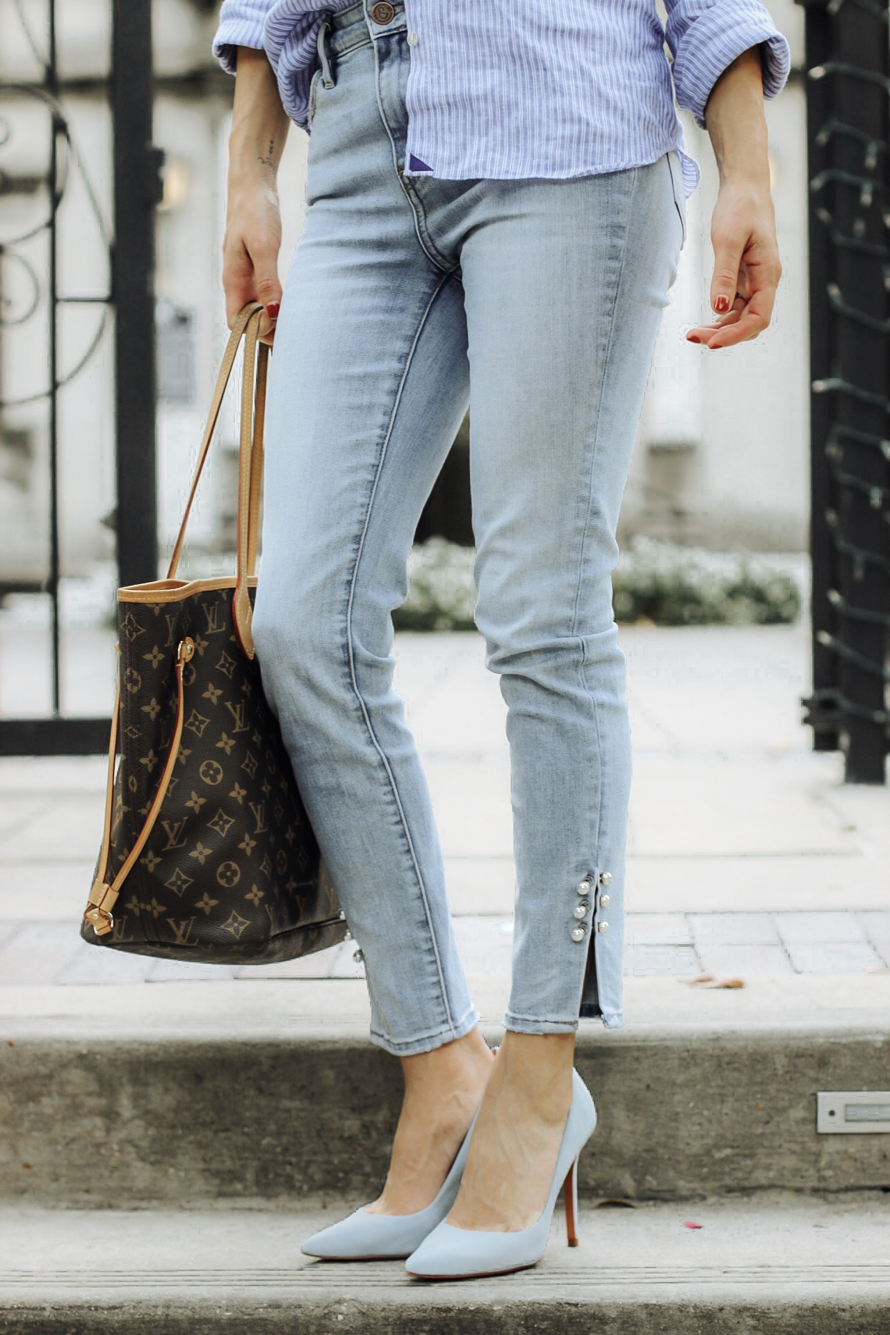 details of embellished jeans and untucked shirt