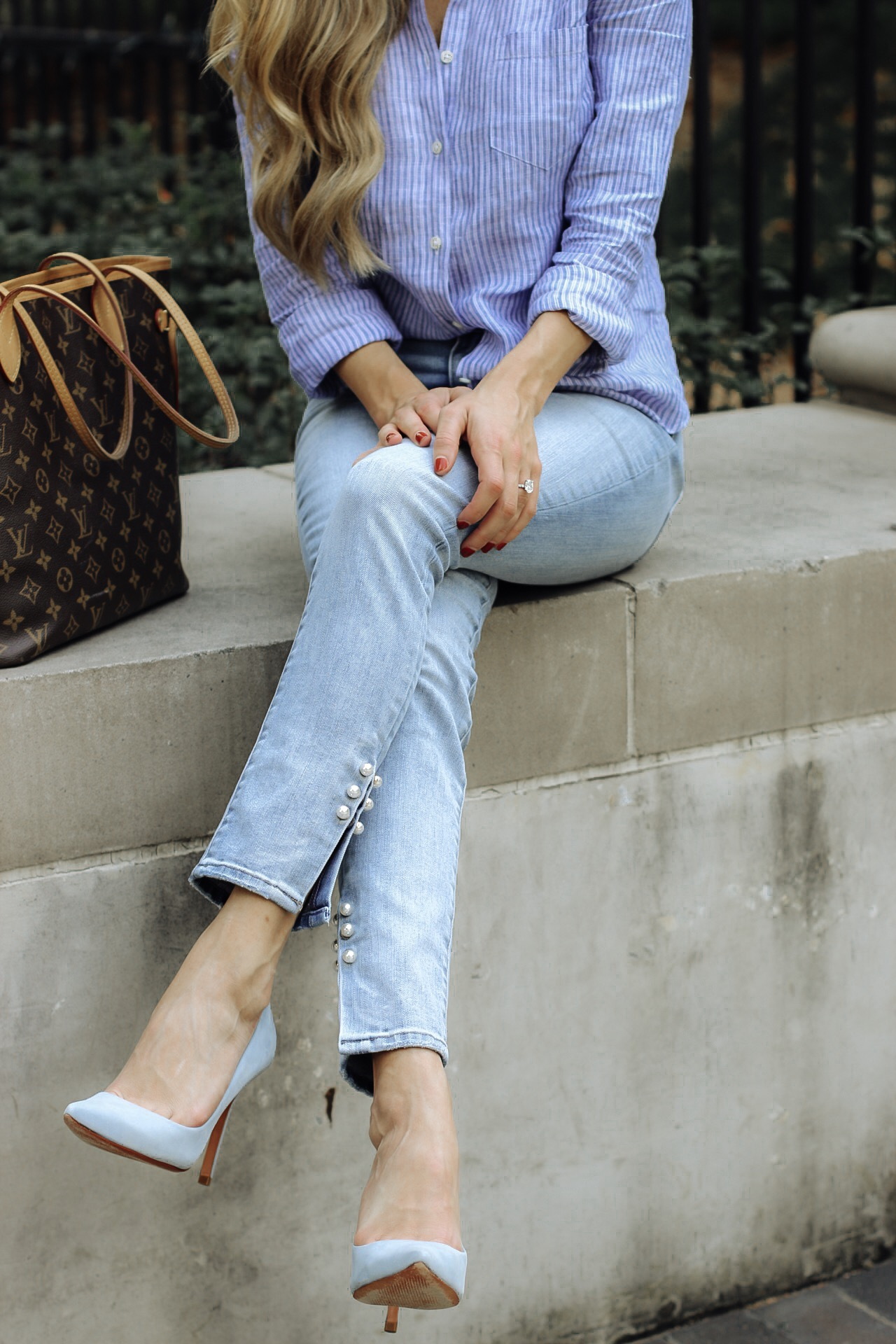 details of a pearl embellishment jean trend and blue heels