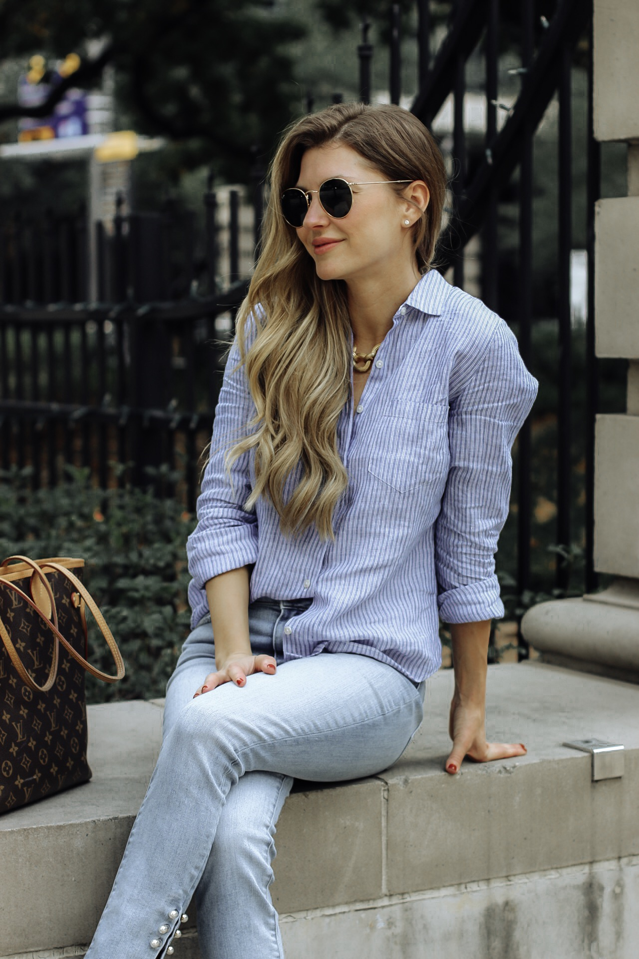 AshLee Williams in pearl embellishment pair of jeans sitting at the library