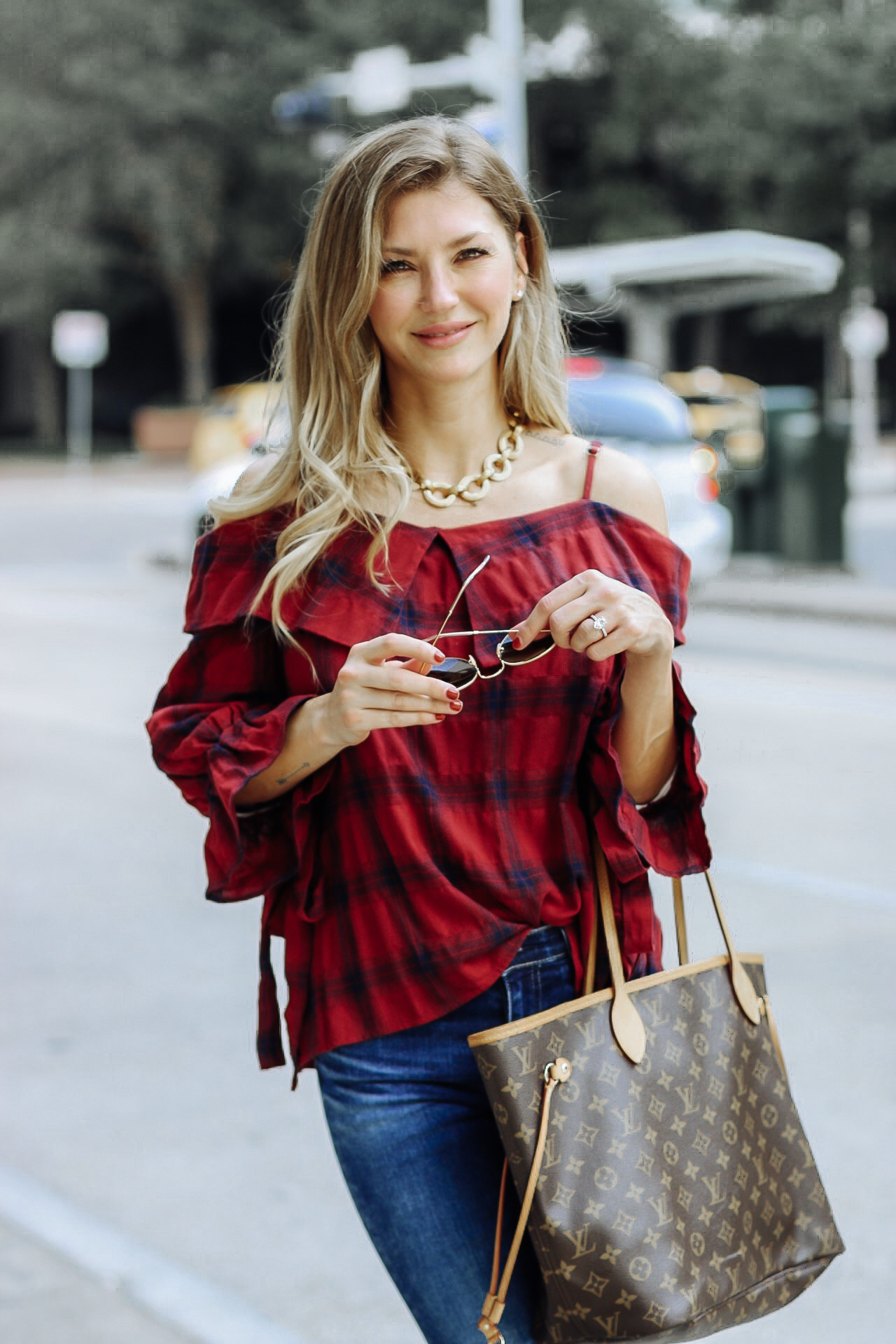 AshLee Frazier in Julie Vos necklace, shop pink blush off the shoulder top and Louis Vuitton bag.