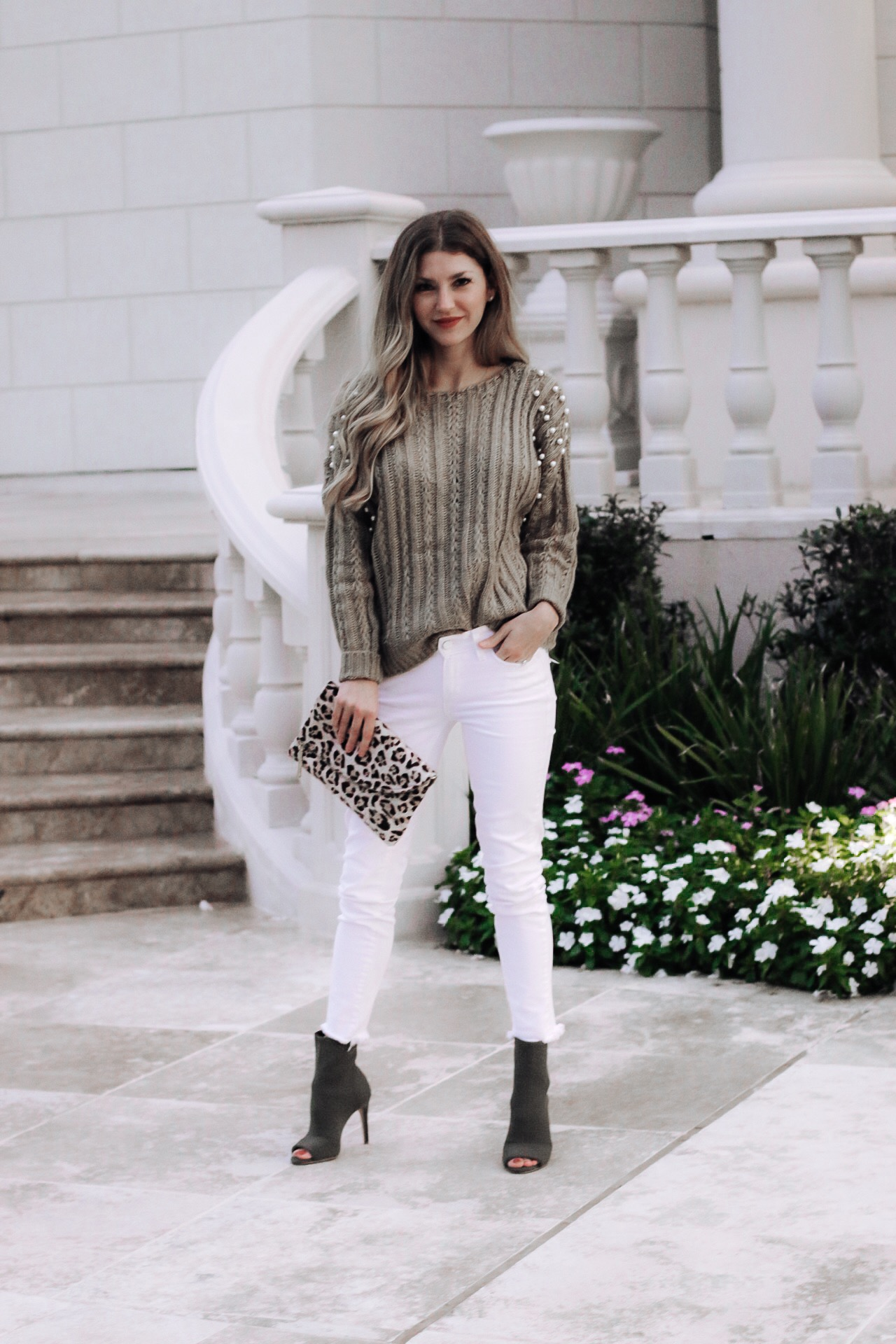 On the front porch of my in-laws wearing shein in pearl sweater, white jeans and ankle booties