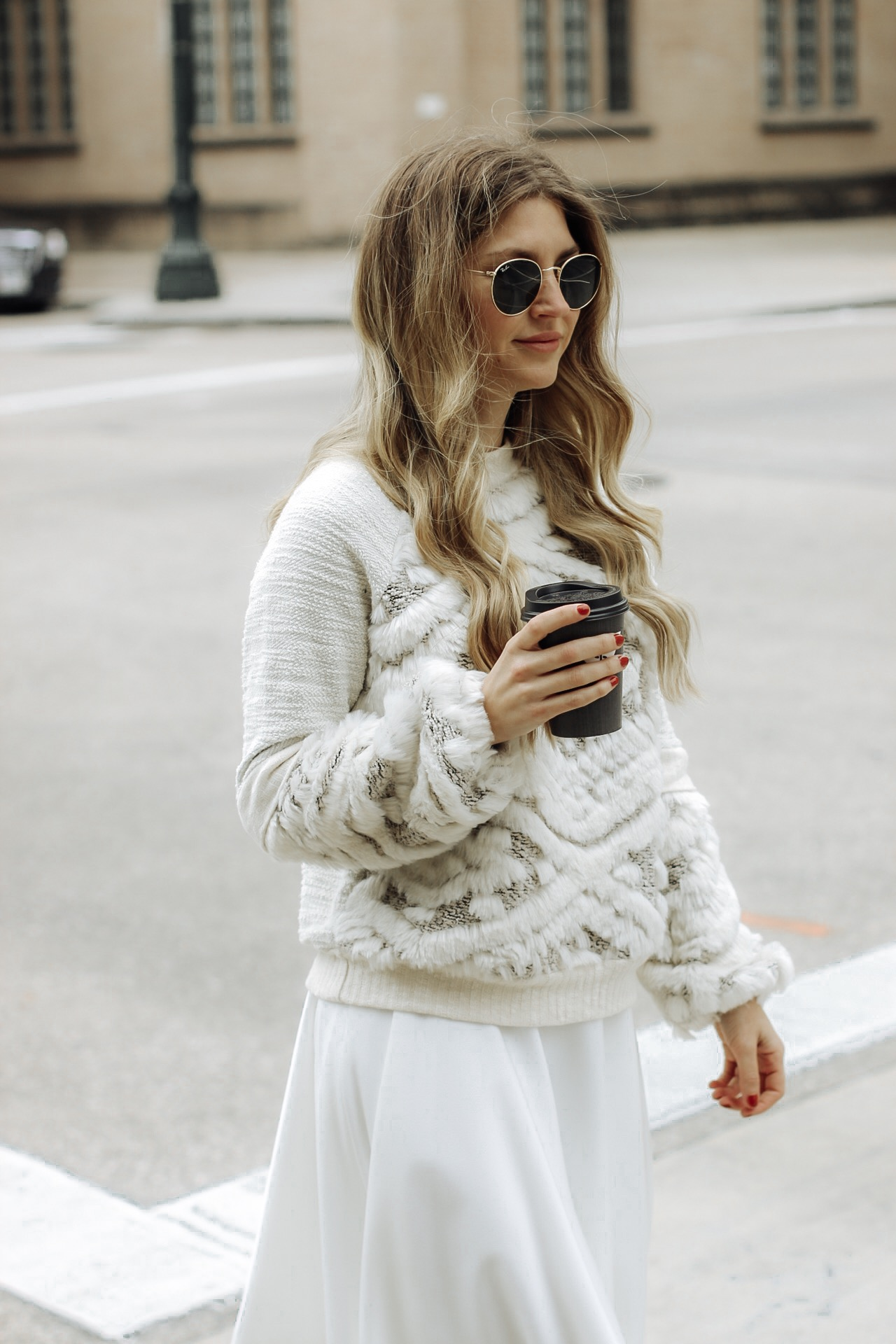 AshLee Frazier in Anthropologie sweater with coffee in hand