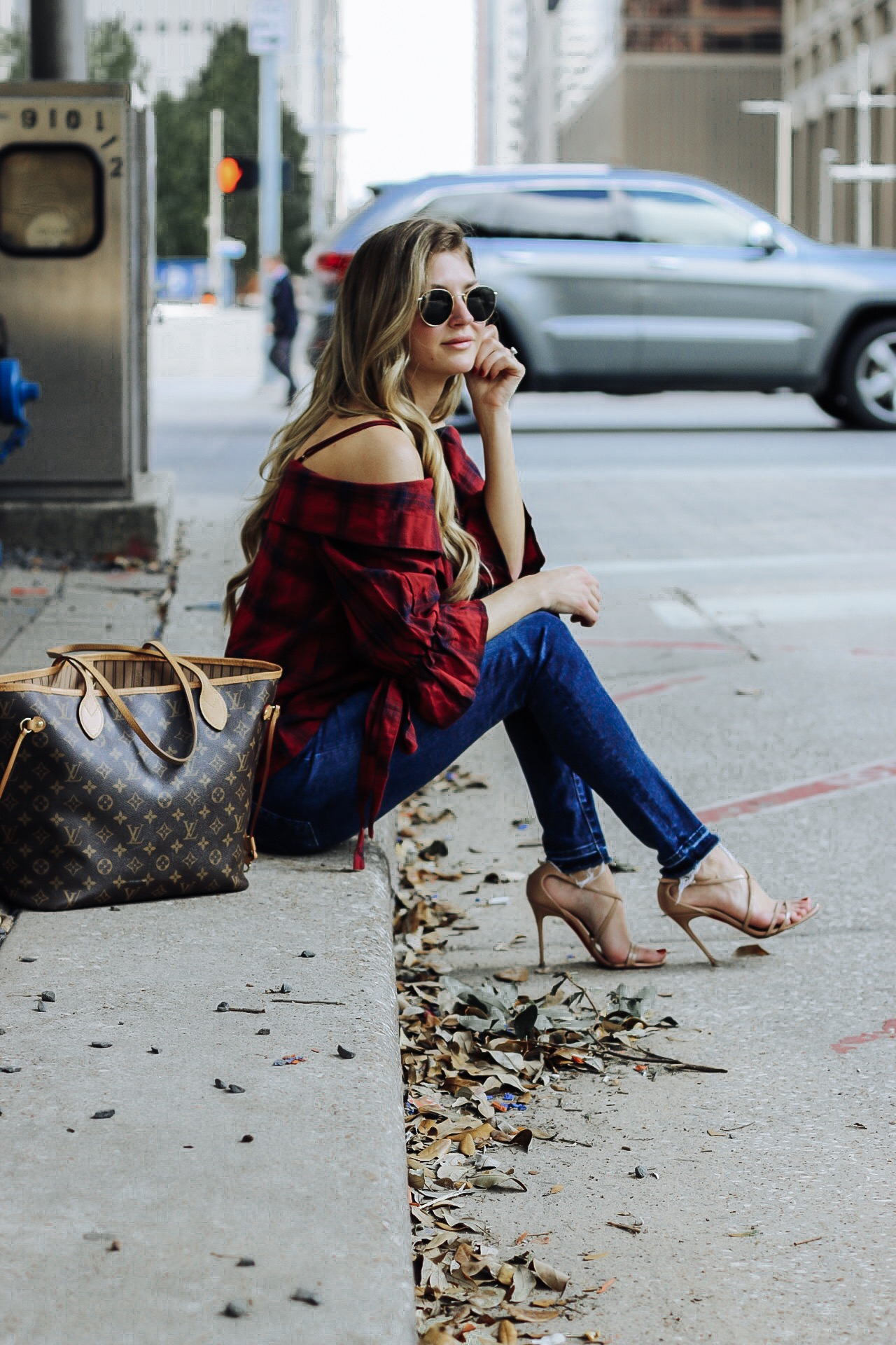 Blogger posing for blog with Louis Vuitton bag and burgundy fall pieces.