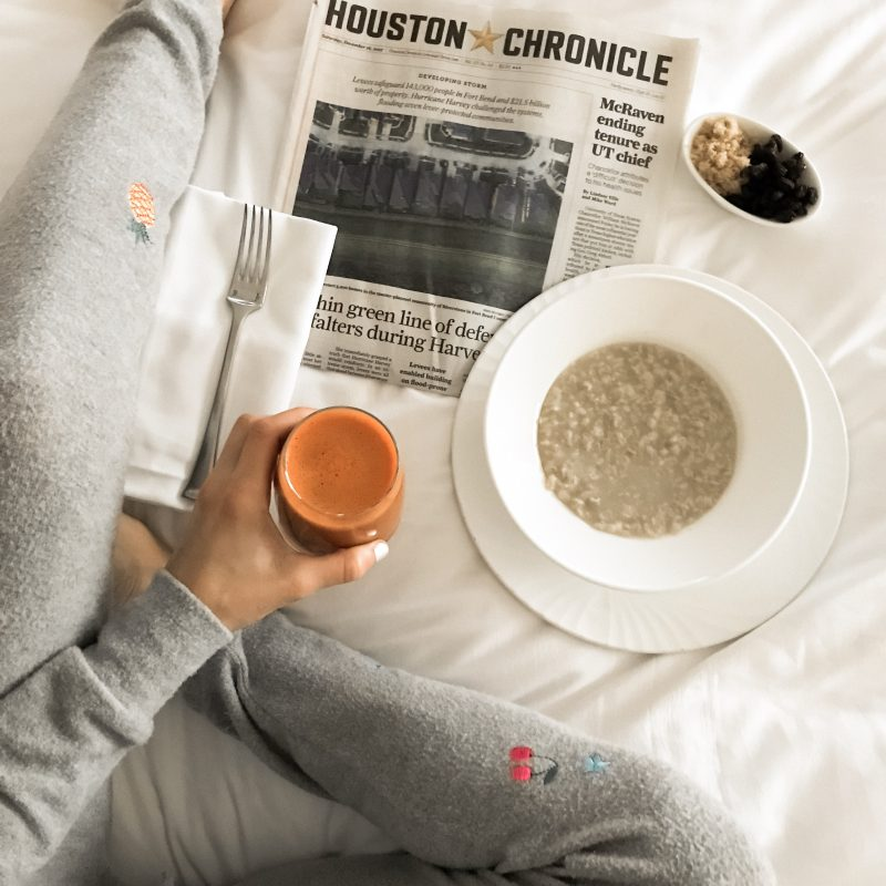 Enjoying a Four Seasons breakfast in bed, wearing Chaser BRand outfit.