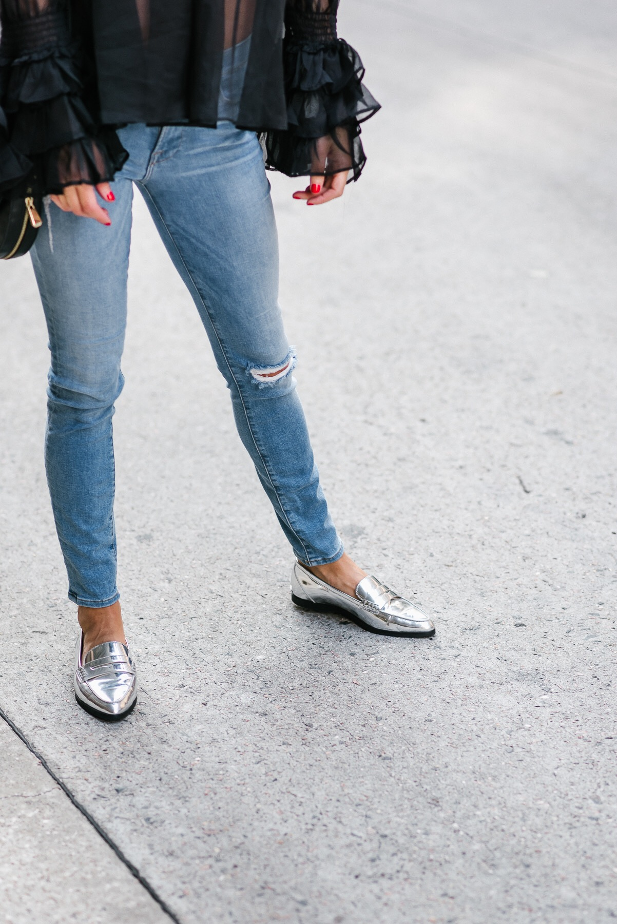 Jeans on blogger from DSTLE and wearing Michael Kors silver shoes