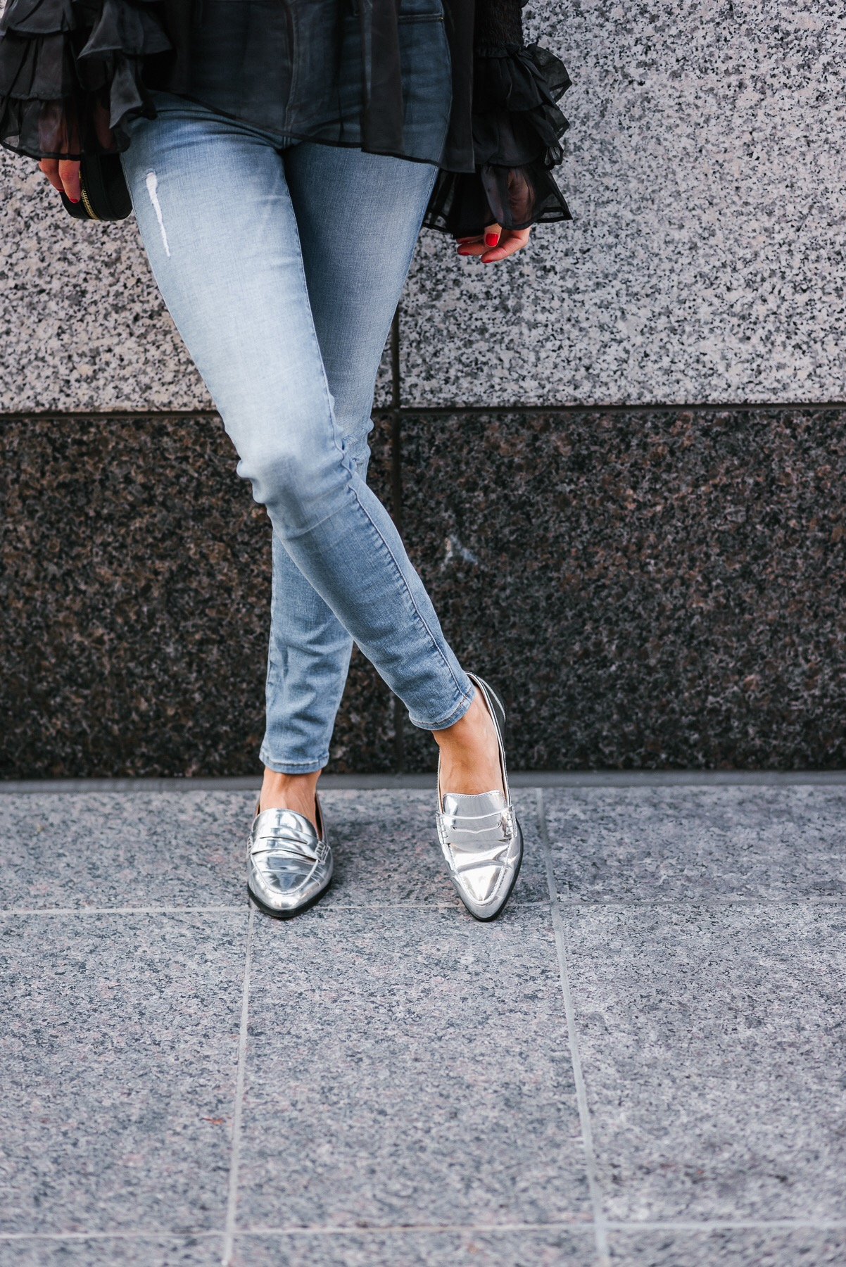 Street style blogger wearing silver Michael Kors shoes and DSTLD denim