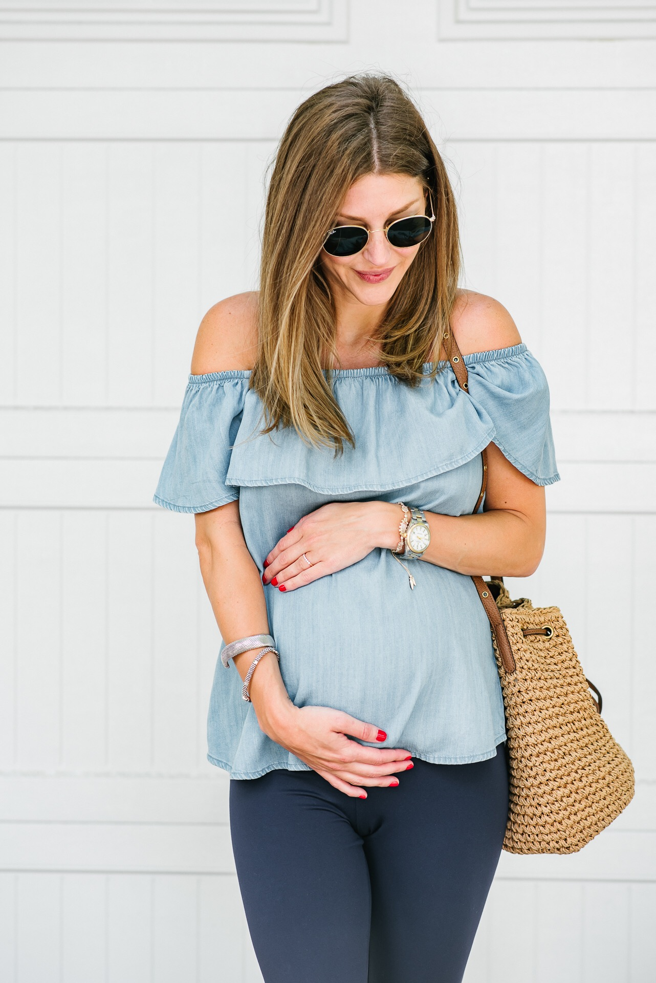 Blogger AshLee Frazier showing off her baby bump