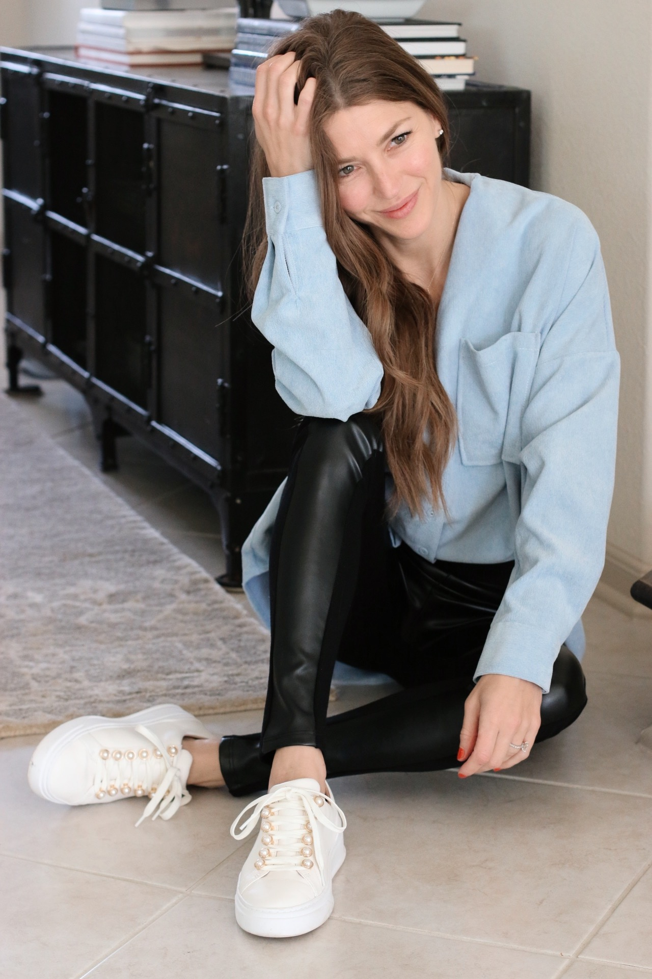 Blue top, leather pants, white sneakers