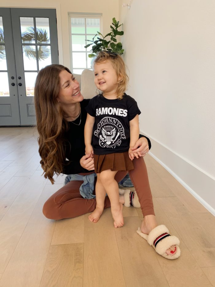 Mommy and me look with black tee and brown skirt and leggings.